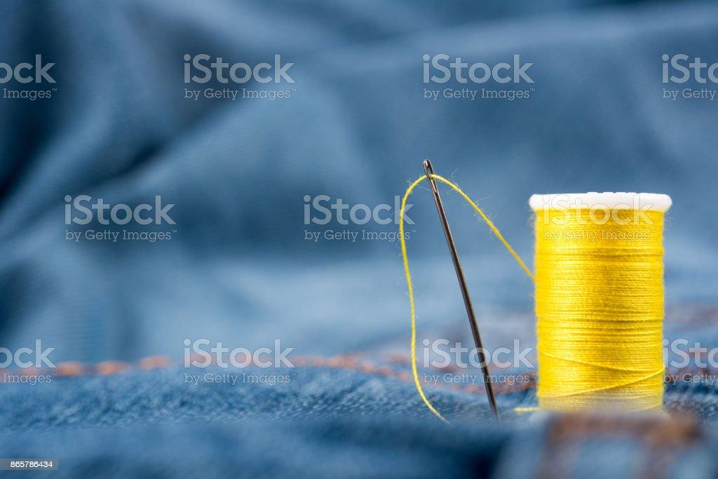 Needles, yarn, sewing thread and fabric stock photo