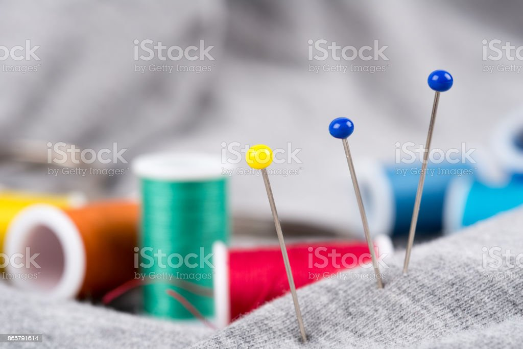Needles, yarn, sewing thread and fabric stock photo