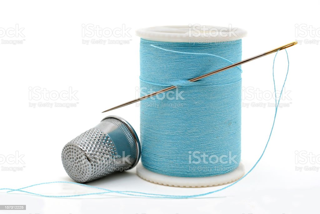 needle,thread,thimble on white background stock photo