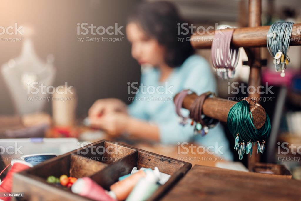 Needlework tools, master at workplace in workshop stock photo