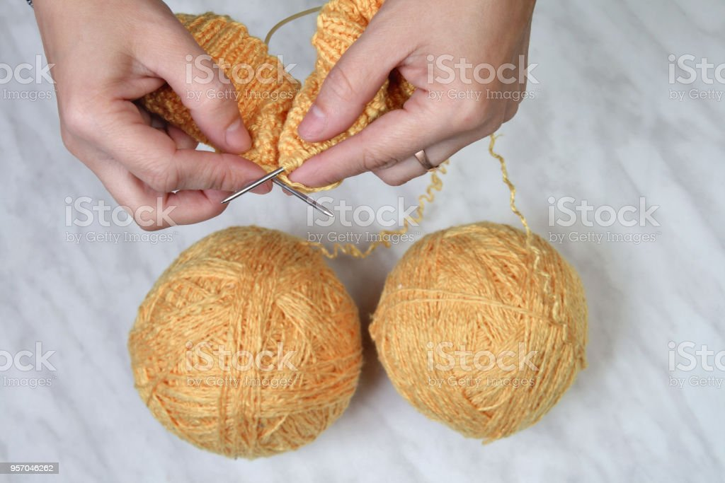 Needlework,knitting on spokes at home stock photo