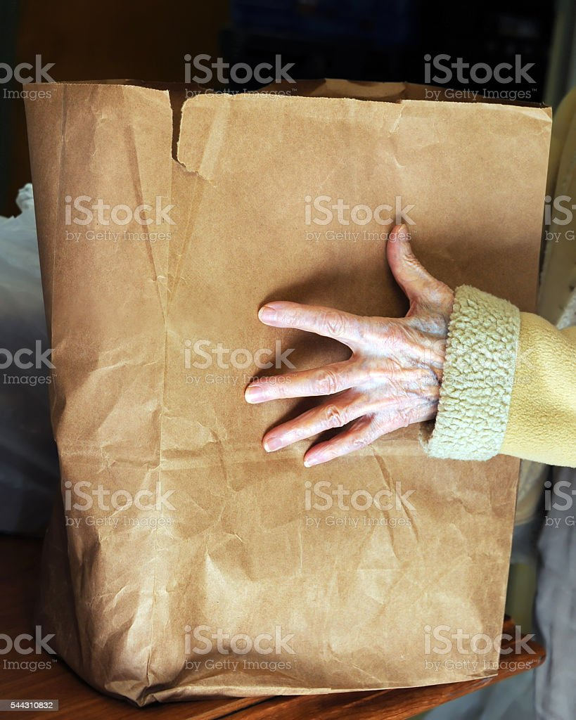Needy Hands at Food Pantry stock photo
