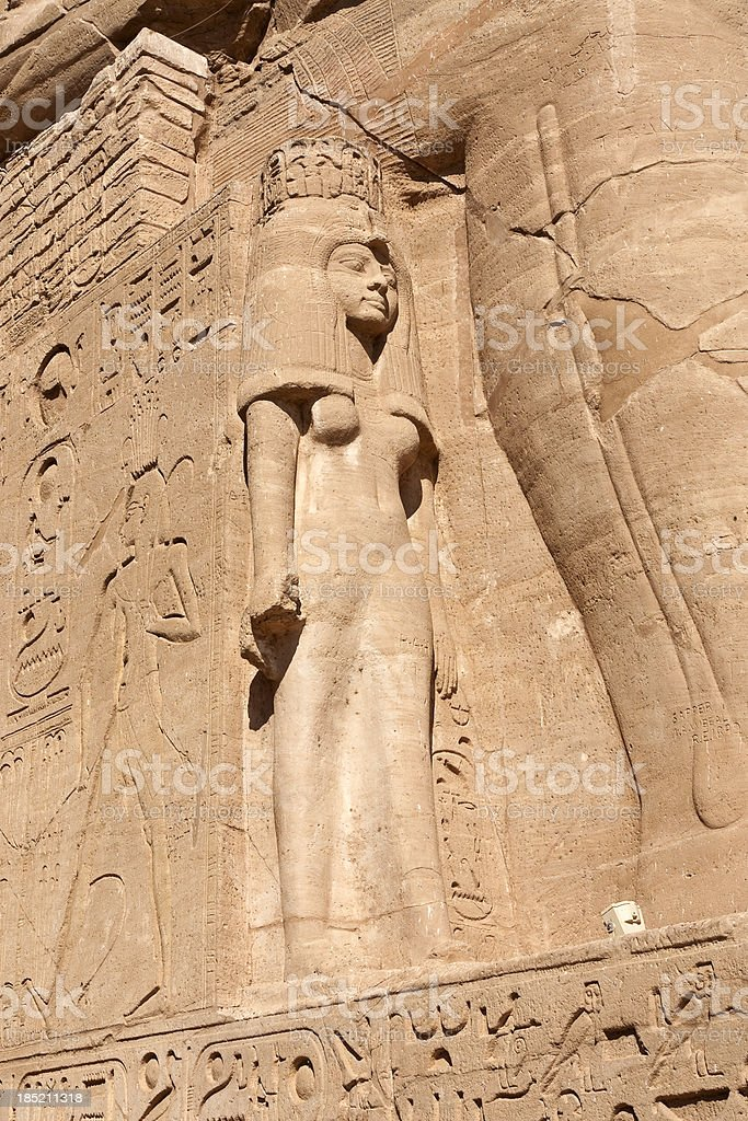 Nefertari beside a colossus of Rameses II royalty-free stock photo