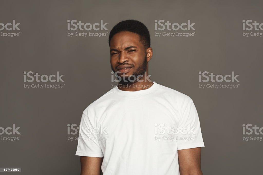 Negative human emotion, black man expressing disgust stock photo