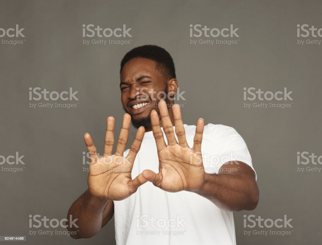 Negative human emotion, black man expressing disgust stock photo