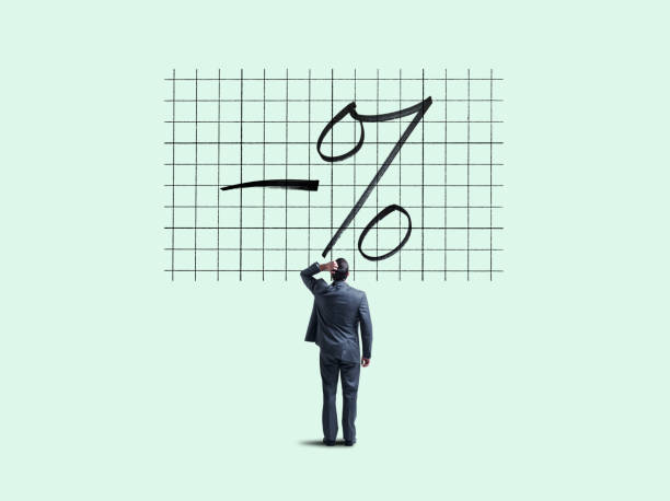 Negative Interest Rates A businessman places his hand on his head as he looks up and is perplexed by a chart indicating fthe concept of negative interest rates. interest rate stock pictures, royalty-free photos & images