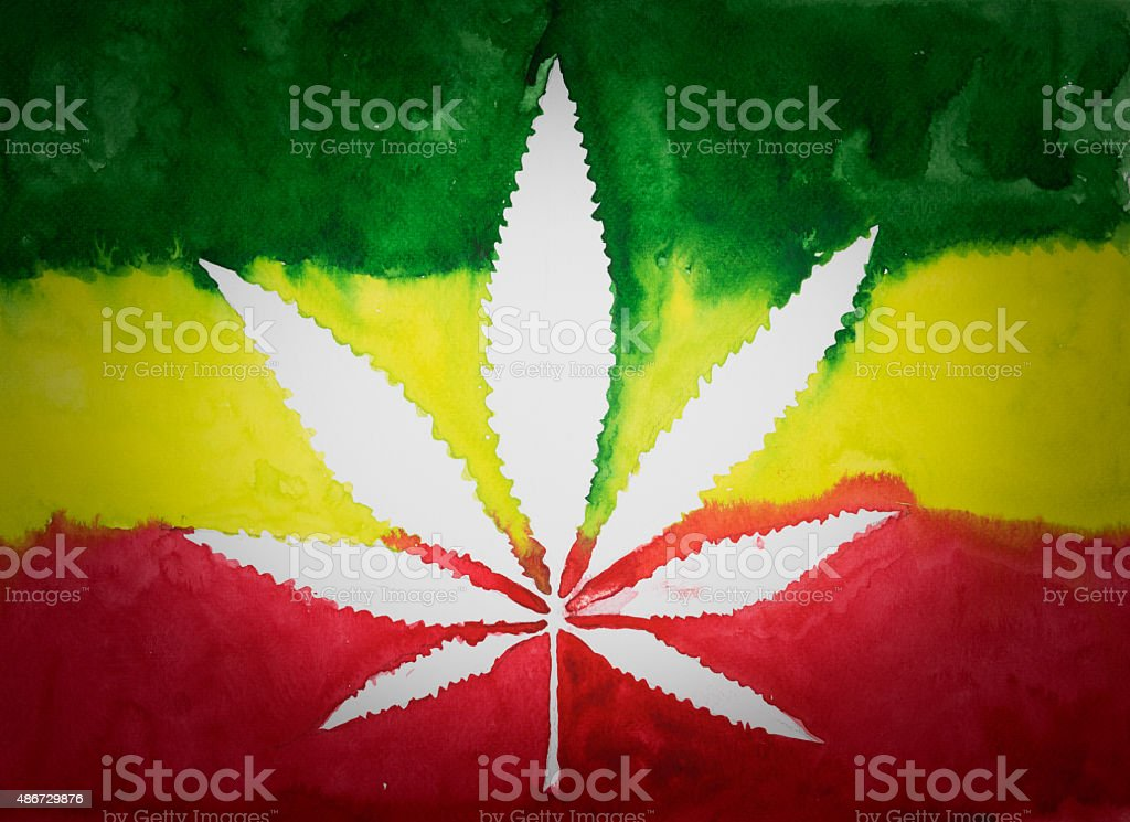 Negative space of cannabis leaf on  rastafarian flag background,watercolor stock photo