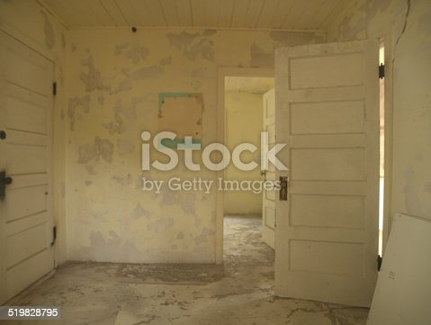 Neglecte, abandoned room of old house with peeling pant