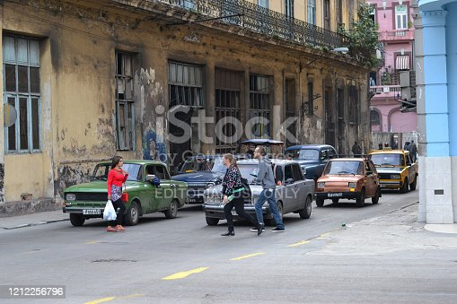 Havana, Cuba - 19th January, 2016: Neglected street in Havana. Classic vehicles from 70s and 80s are the the popular view on the streets in Cuba.