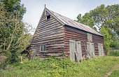 istock Neglected wooden barn with a corrugated tin roof 1203728857