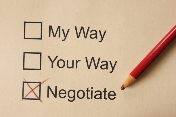 Negotiate and compromise related check boxes stock photo