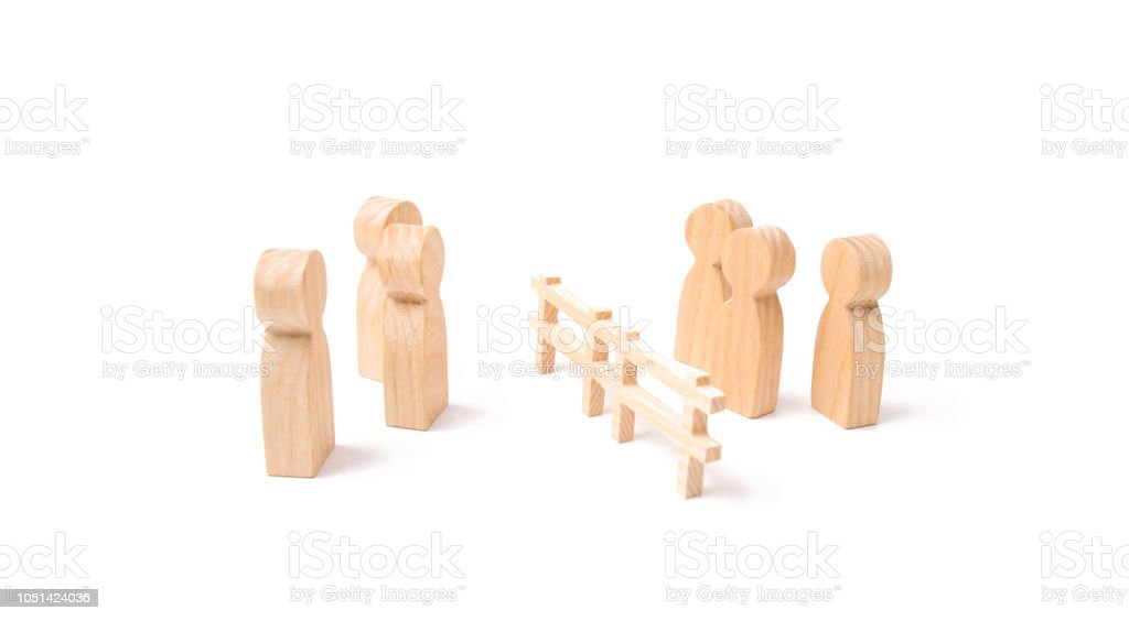 Negotiations of businessmen. A wooden fence divides the two groups discussing the case. Termination and breakdown of relations, breaking ties. Contract break, conflict of interests. stock photo