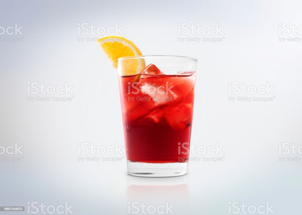 Negroni cocktail drink with ice cubes and orange. A glass with Campari (bitter). stock photo
