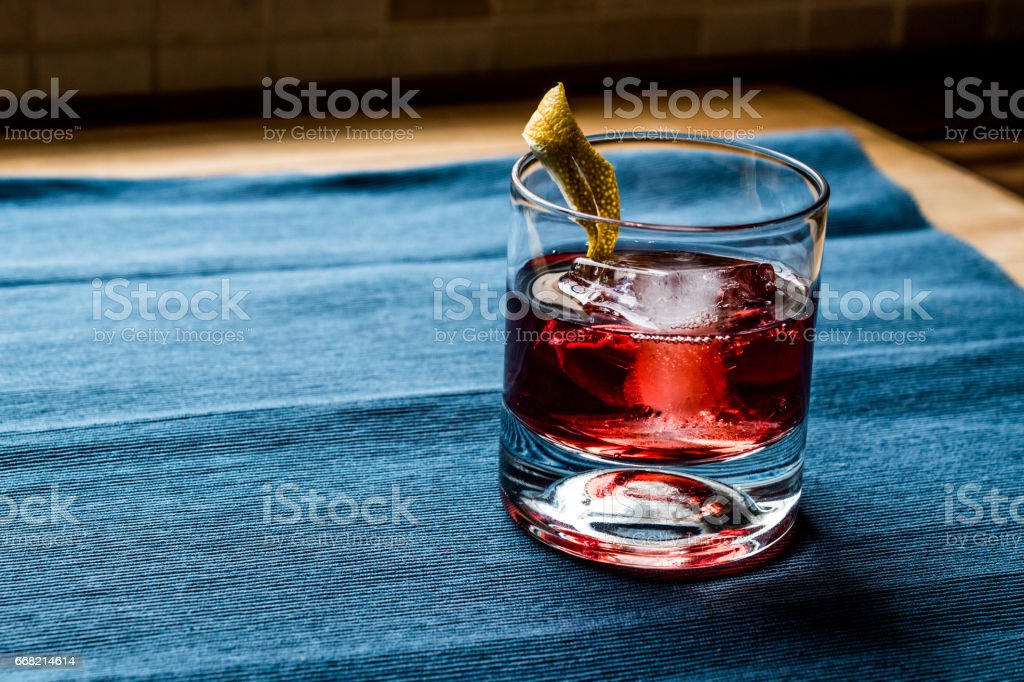 Negroni Cocktail with lemon peel and ice. stock photo