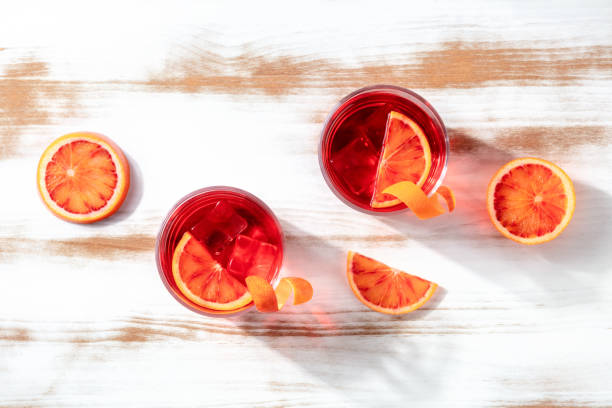 Negroni cocktails with blood oranges, overhead flat lay shot stock photo