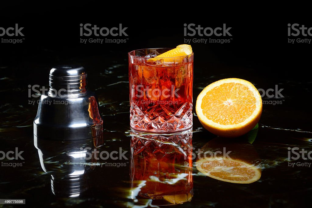 negroni on the rocks and orange stock photo