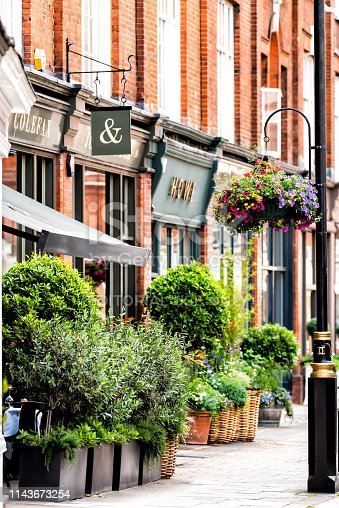 istock Neighborhood district of Pimlico Street hanging flower basket decorations 1143673254