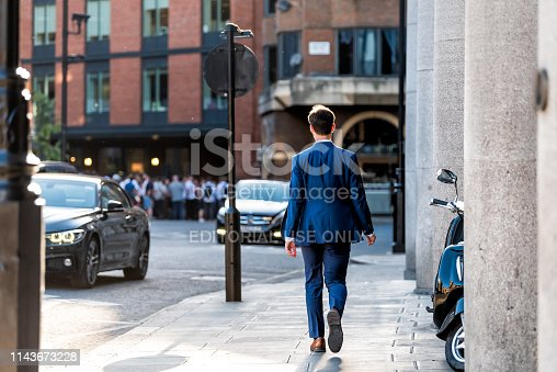 istock Neighborhood district of Pimlico Street with businessman man walking 1143673228