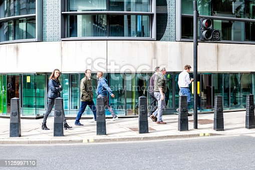 istock Neighborhood district of Victoria of Pimlico with building and many people pedestrians walking home from work commuting 1125997110