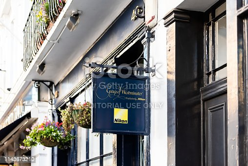 istock Neighborhood district of Victoria of Pimlico with hanging flower baskets in old historic street summer 1143673210
