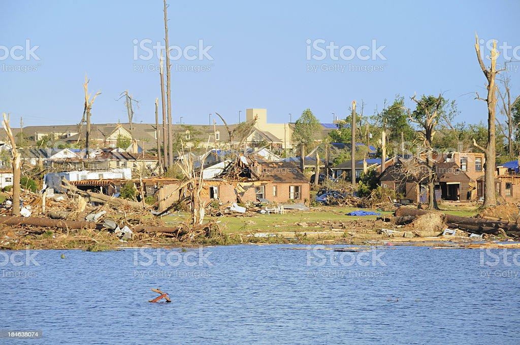 Neighborhood of destroyed homes by lake stock photo