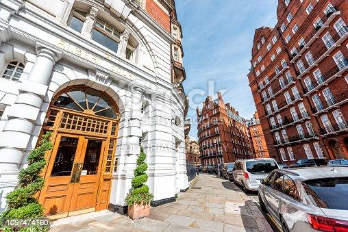 1125782554 istock photo Neighborhood of Knightsbridge or Kensington street with old vintage historic traditional style brick Victorian flats architecture 1097474160