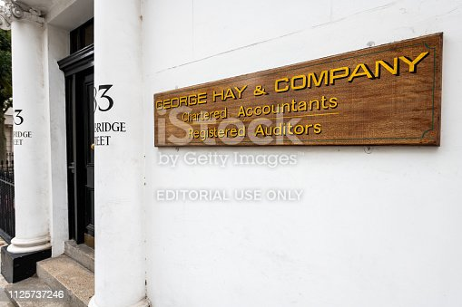 512860403 istock photo Neighborhood of Pimlico on Cambridge street with historic architecture and closeup of sign for George Hay and Company Accountants 1125737246