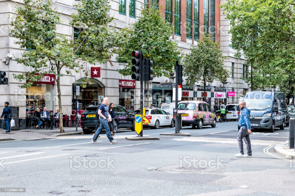 Neighborhood of Pimlico Victoria Westminster with people crossing...