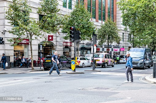 istock Neighborhood of Pimlico Victoria Westminster with people crossing street by Pret A Manger cafe restaurant road 1125994164