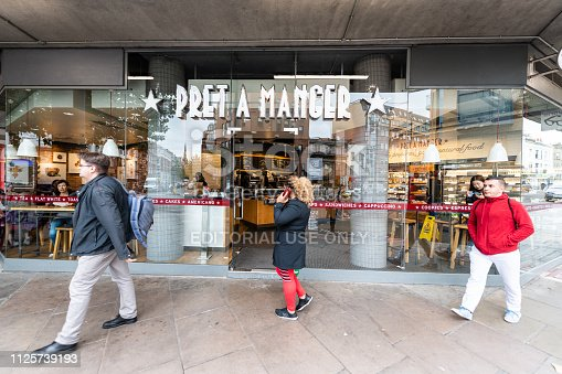 512860403 istock photo Neighborhood of Pimlico Victoria with people walking on sidewalk by Pret A Manger modern cafe restaurant sign entrance 1125739193