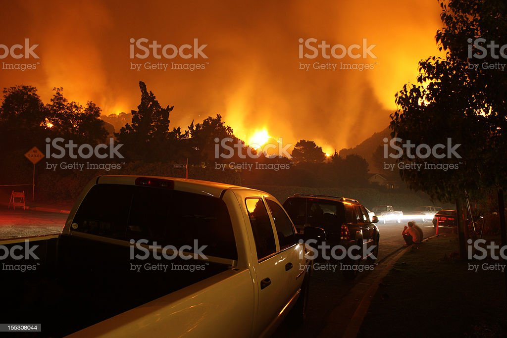 Neighborhood On Fire At Night stock photo
