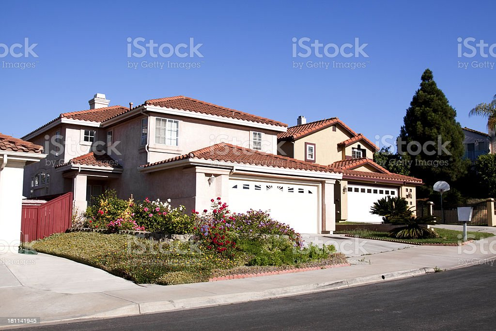 Neighborhood Stucco Home Exterior and Blue Sky royalty-free stock photo