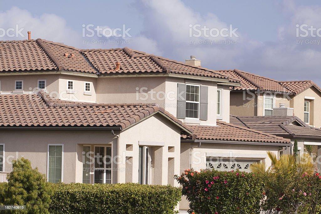 Neighborhood Stucco Home Exterior and Sky stock photo