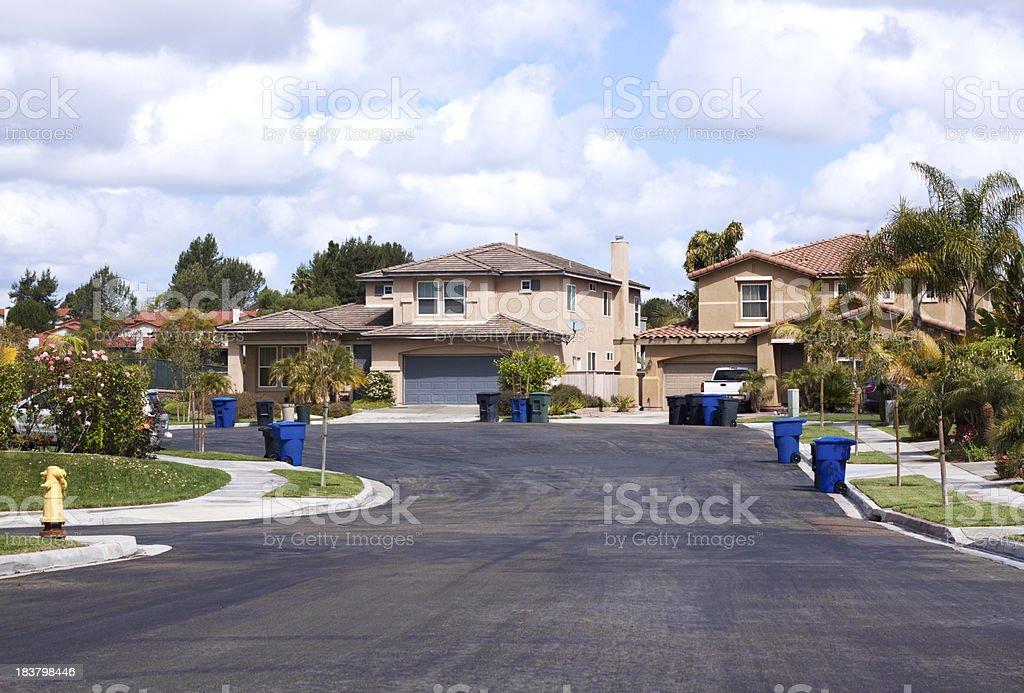 Neighborhood Stucco Homes and Trash Day stock photo