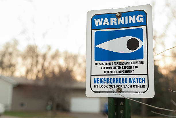 Neighborhood watch sign outside home stock photo