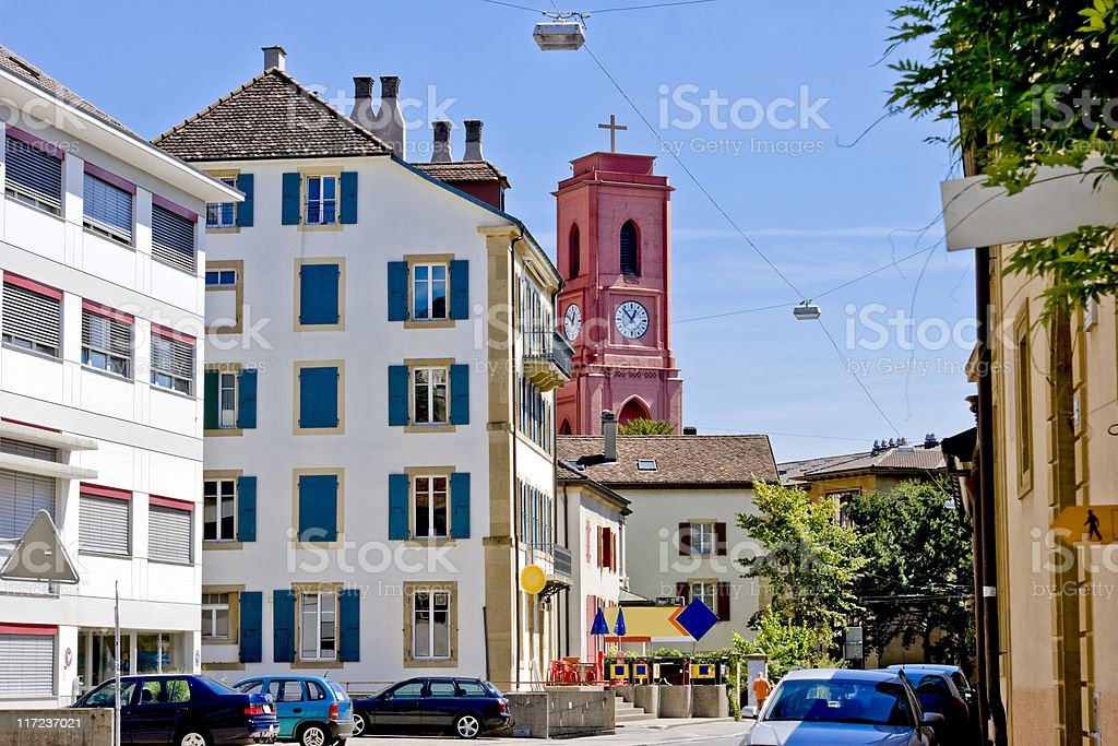Neighborhood with Cafe, house, Church, in Neuchatel stock photo