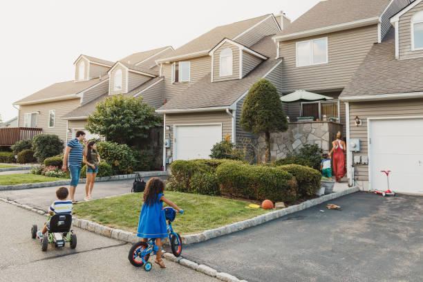 Neighbors talking and kids playing stock photo