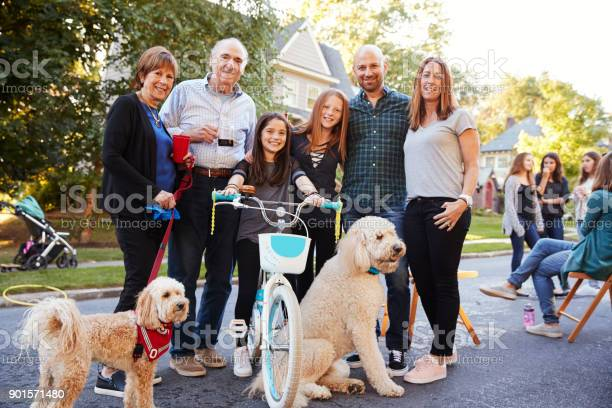 Neighbours with pet dogs smiling to camera at a block party picture id901571480?b=1&k=6&m=901571480&s=612x612&h=npq9gvx3ynyoxpmlhujvvh8pl5p5l6lunras4yhvtyq=