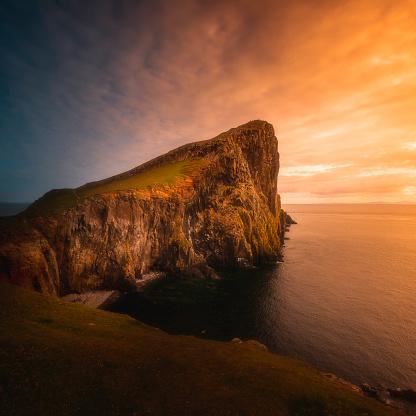 The neist point at sunset. Famous cliff head, landmark and tourists destination on Isle of Skye, Scotland, UK.
