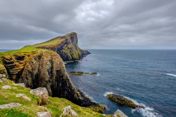neist point is the most westerly headland on the island of skye and hosts one of the most famous lighthouses in scotland - headland stock pictures, royalty-free photos & images