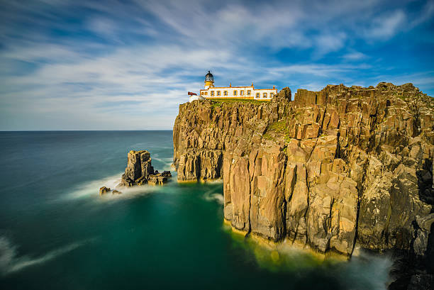 Neist Point lighthouse at Isle of Skye in Scotland Neist Point lighthouse at Isle of Skye, Scottish highlands, United Kingdom. Long exposure isle of skye stock pictures, royalty-free photos & images