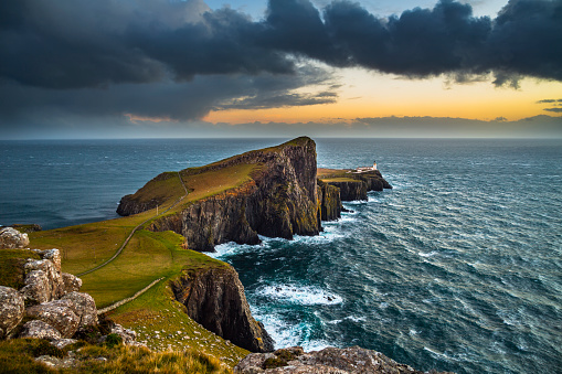 Neist Point a famous lighthouse in Scotland that can be found on the most westerly tip of the Isle of Skye near the township of Glendale. Moody sky with rain clouds.