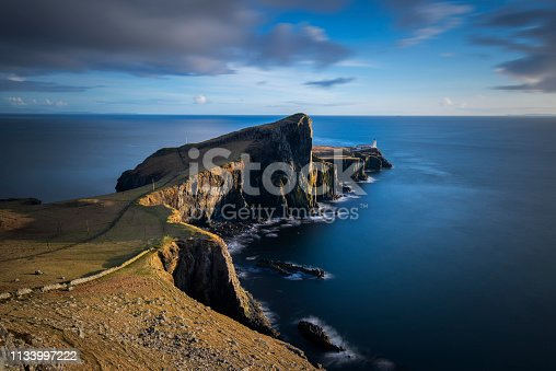 A stunning sunset with the famous Neist Point peninsula on the Isle of Skye in the Scottish Highlands.