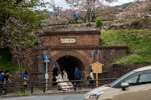 Kyoto, JAPAN - Apr 3 2021 : Nejirimanpo Tunnel under the Keage Incline in cloudy day. The tunnel is made with bricks piled in a spiral manner (appearing to be swirling).