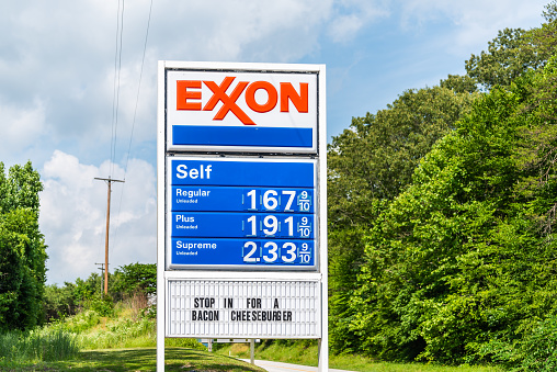 Roseland, USA - June 9, 2020: Famous scenic road route 151 Patrick Henry highway in Nelson County, Virginia with exxon gas station sign and cheap prices with bacon cheeseburger