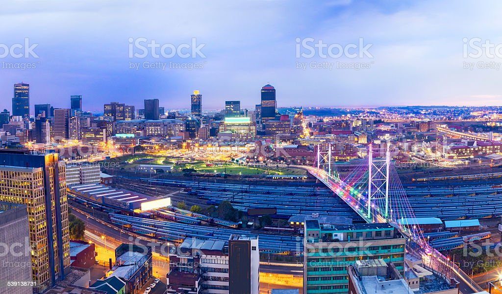 Nelson Mandela Bridge in the evening with Johannesburg stock photo