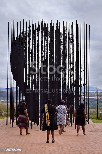 Howick , South Africa - 2 November 2019: Black women walking up to the sculpture showing the face of Nelson Mandela when seen from a certain angle. Artwork created by Marco Cianfanelli