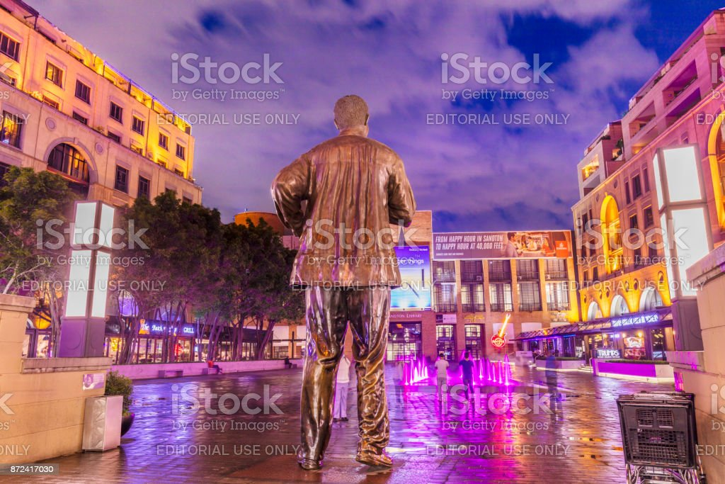 Nelson Mandela Square with the statue from behind stock photo