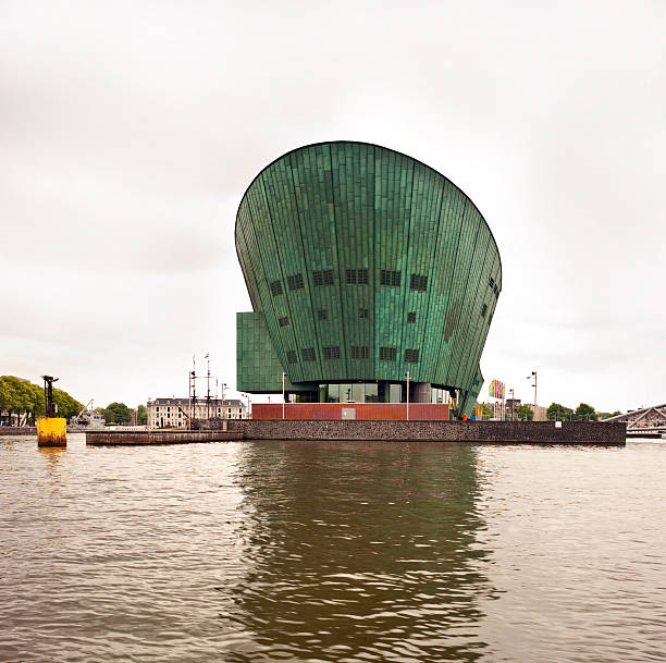 Nemo, Amsterdam Amsterdam, Holland- May 30, 2012. NEMO, the largest science centre in the Netherlands. An immense green building is located about 15 minutes walk from Amsterdam Central Station. The fascinating construction aa often compared to a ship aa is located above the IJ Tunnel. nemo museum stock pictures, royalty-free photos & images