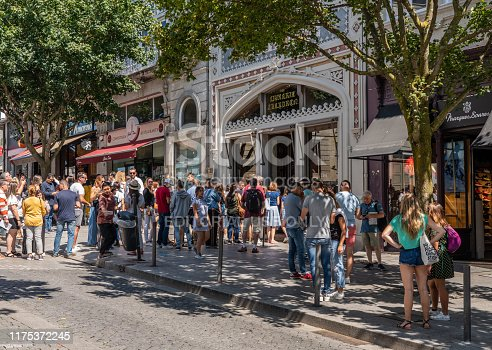 Porto, Portugal - 12 August 2019: Tourists and fans queue to enter the famous Lello bookshop in Oporto